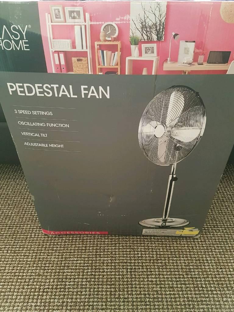 Chrome pedestal fan New in box
