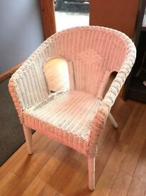 Vintage wicker chair suit as baby feeding chair or type of nursing chair.