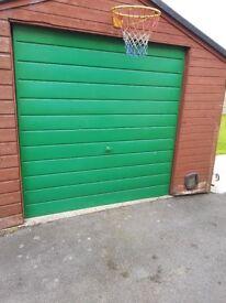 Green metal garage door