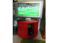 Red circular TV and console cabinet, solid wood with sliding doors