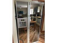 Samsung Fridge Freezer with ice & water dispenser and mirrored doors.