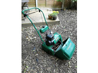 Qualcast petrol lawnmower with scarifier cartridge for sale