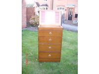 Vintage wood chest of drawers, top compartment with mirror.