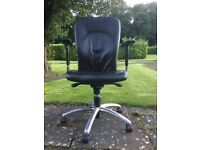 A black genuine leather office chair