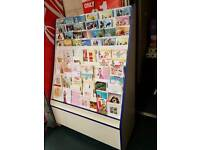 Greeting cards stand with storage
