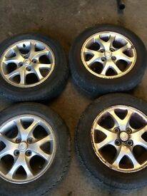 Toyota Yaris 1999- 2005 set of 4 alloy wheels 2 very good tyres