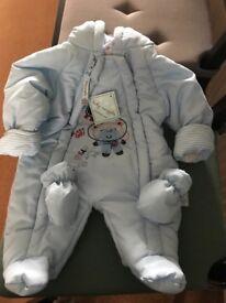 Newborn snowsuit with label