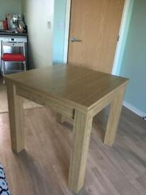 Next extendable dining table