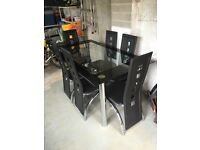 Black glass and chrome 6 seater table & chairs