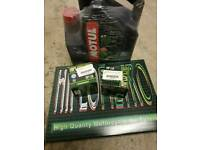 Motorcycle services items - 5L 10W-40 Oil, 2 Oil filters, 1 Air filter