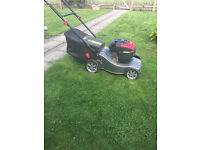 For sale petrol lawn mower only about 6 months old