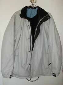 New windproof durable cream thermal padded winter jacket MEDIUM / LARGE in NEW condition.