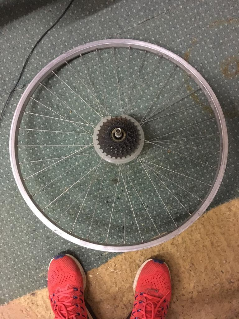 3 bike wheels. 2 are new and 1 is used.