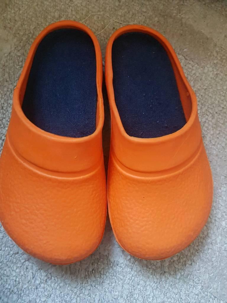 Orange croc style open shoes size 8-9