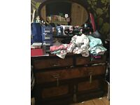 Antique wooden dresser with mirror and drawers