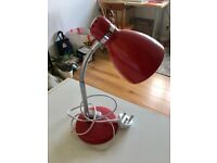 red desk lamp with bulb