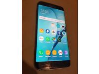 Samsung Galaxy S7 Edge Black smartphone unlocked, has cracks see pic for details. no offers