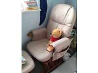 Nursing chair with a rocking stool. Padded cushions, 3 position recline, solid wood frame.