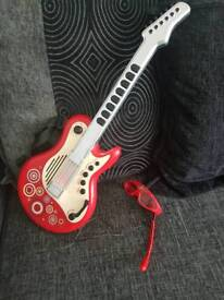 ELC guitar and glasses/microphone