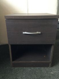 2 brown bedside tables