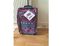 Snazzy suitcase bought by mistake! Small suitcase on wheels, brand new, unused. Labels attached.