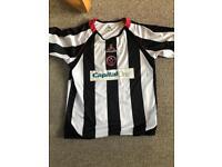 Sheffield United away shirt.