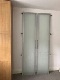 Ikea PAX glass wardrobe doors.