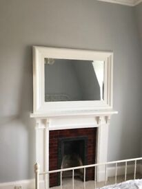 Large solid wood painted mirror.
