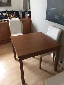 IKEA extended table and four chairs in great condition