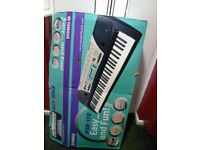 Yamaha keyboard with box