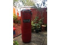 TITLE, Leather punching bag with support chains in good condition