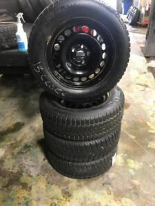 215 60R 16 UNIROYAL TIGER PAW WINTER SNOW TIRES CHEV CRUZE TRAX RIMS 5X105 BOLT PATTERN 11/32 TREAD EXCELLENT CONDITION