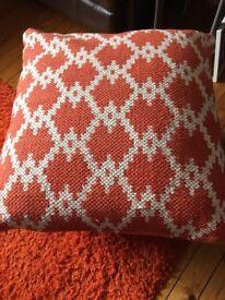 Orange/white patterned floor cushion