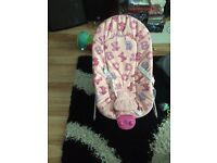 Baby bouncer with massager and songs