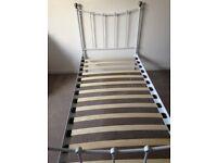 Single metal framed bed in white