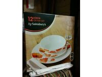 Brand new 12 piece dinner set in box.