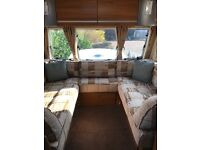 Mint condition 2010 caravan with many extra, motor mover, half awing etc.