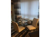 Glass table and leather chairs (4)