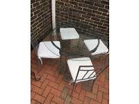 Glass table and chairs for the garden