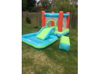 Bouncy castle with detachable pool and slide