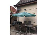 Parasol for outdoor garden table.