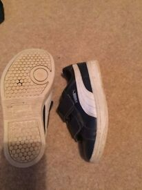 Navy blue leather Trainer's with a white sole and puma detail, size uk 11.