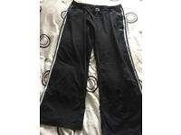 Pair of Black Adidas bottoms. Size 22