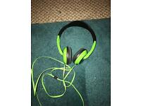 Green skullcandy headphones