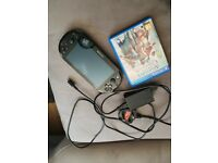 Ps vita slim + memory card + charger cable + game