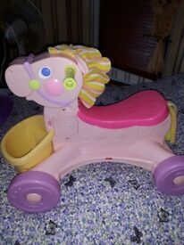 Fisher price rid on horse