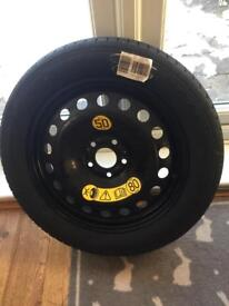 Brand new unused space saver wheel and tyre