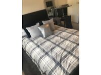 Beautiful leather look double sleigh bed and mattress for sale