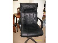 For Sale black leather swivel office chair.