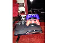 PS3 slim 25 games 2 coloured wireless controllers, + buzz game & 4 wireless buzzers